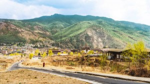56743075-road-and-village-with-high-mountain-and-huge-cloud-above-thimphu-valley-bhutan